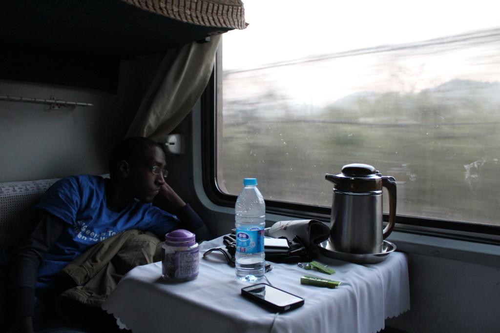 Senai, looking contemplative as the train rolls through China's countryside.