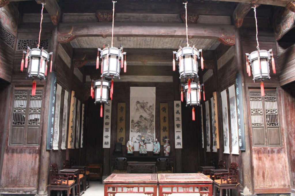 Ornate wooden furniture and various idols is common place